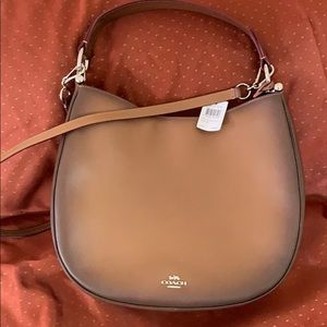 Gorgeous Coach Nomad purse. Brand new with tags!!
